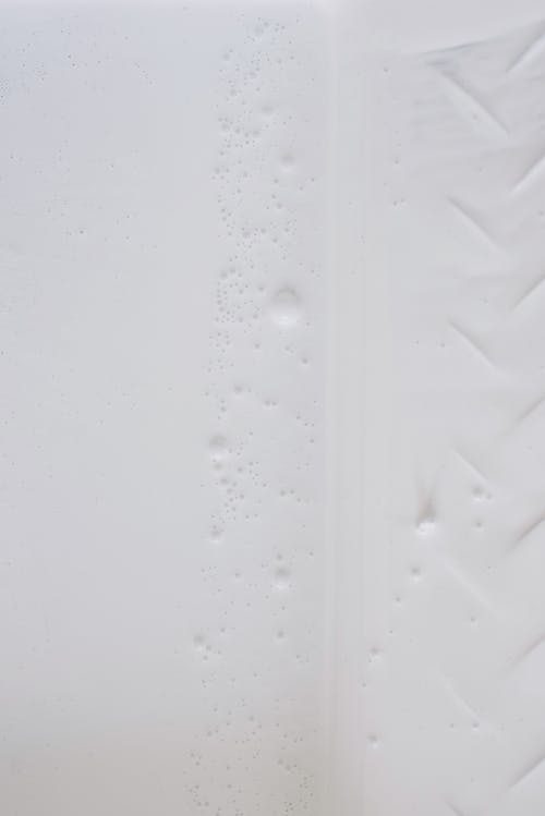 Uneven white surface with grains and traces