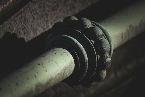 Old rusty metal pipe in dark tunnel