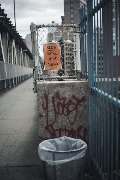 White Plastic Bag on Gray Concrete Wall
