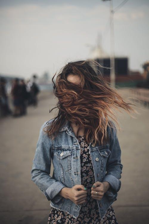 Woman in Blue Denim Jacket Standing on Street