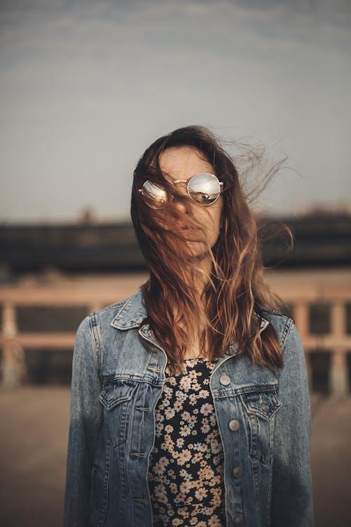 Woman in Blue Denim Jacket Wearing White Framed Sunglasses