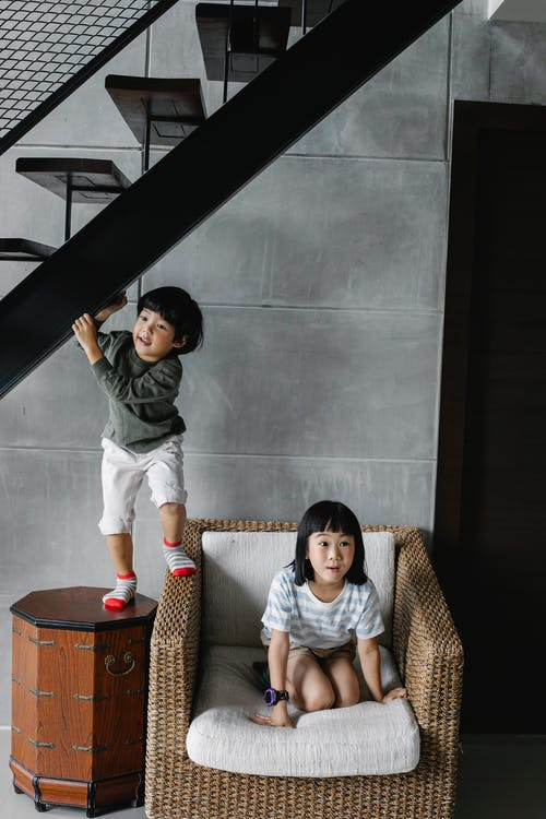 Playful little ethnic siblings having fun at home