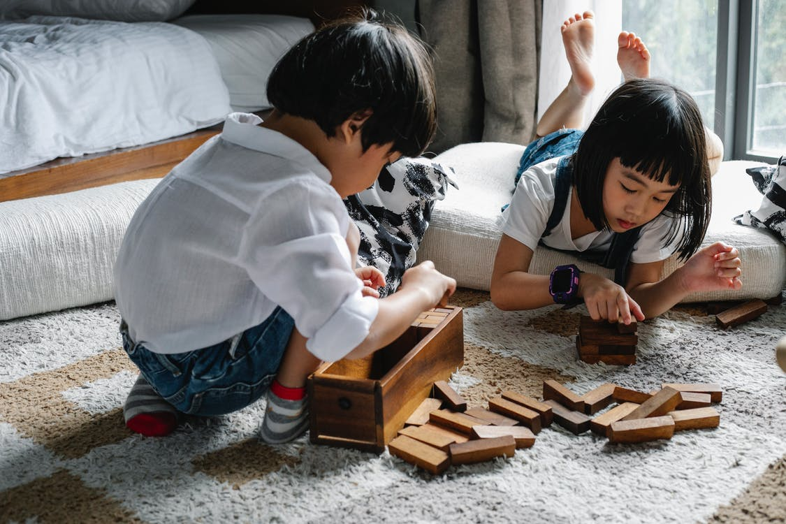 Asian kids playing with wooden blocks