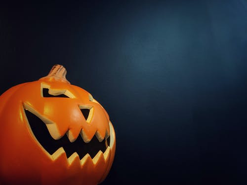 Free stock photo of blue background, halloween, mobile camera, orange pumpkin