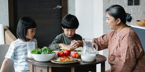 Asian woman preparing healthy breakfast for children