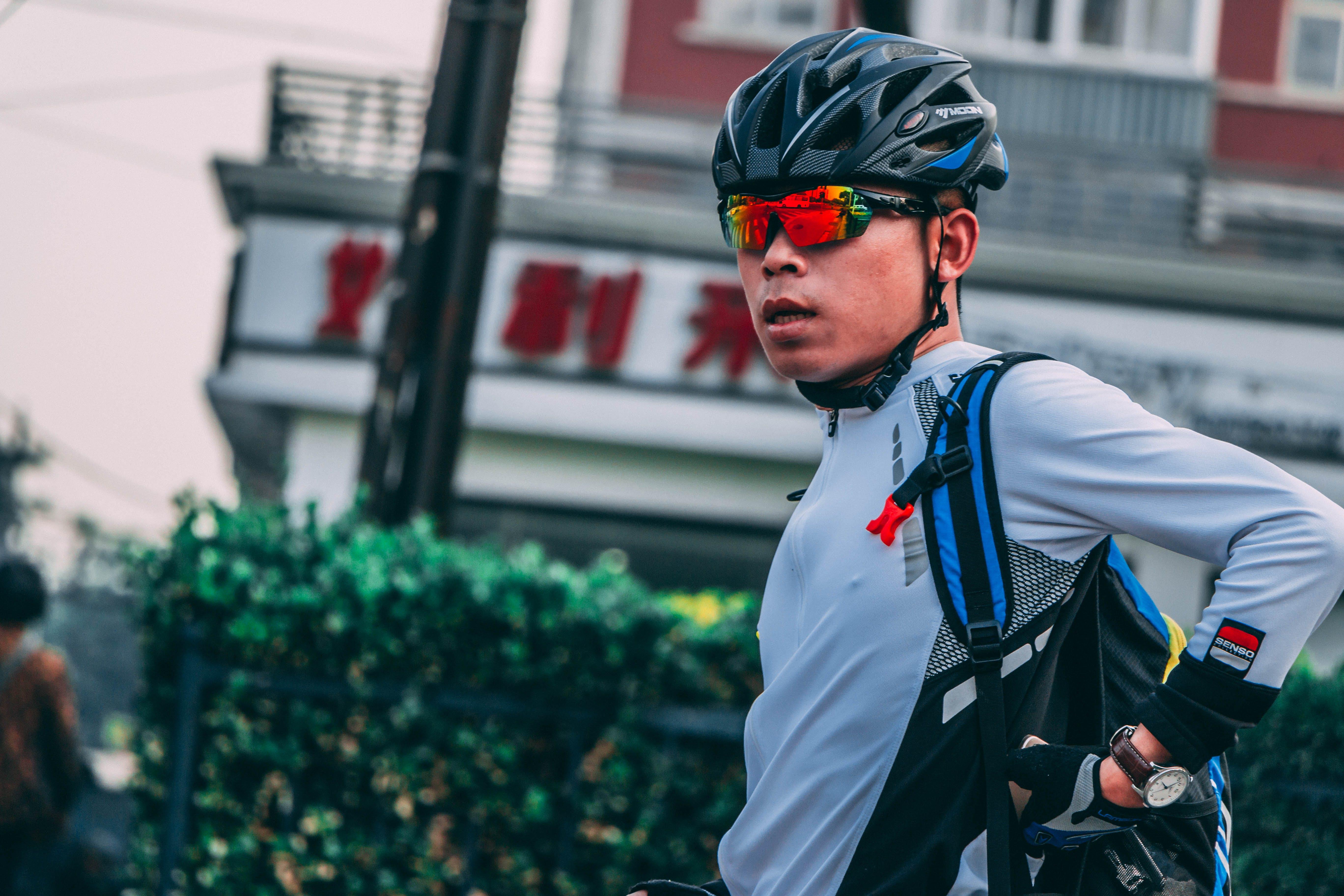 Man Wearing Sports Sunglasses and Black Bike Helmet
