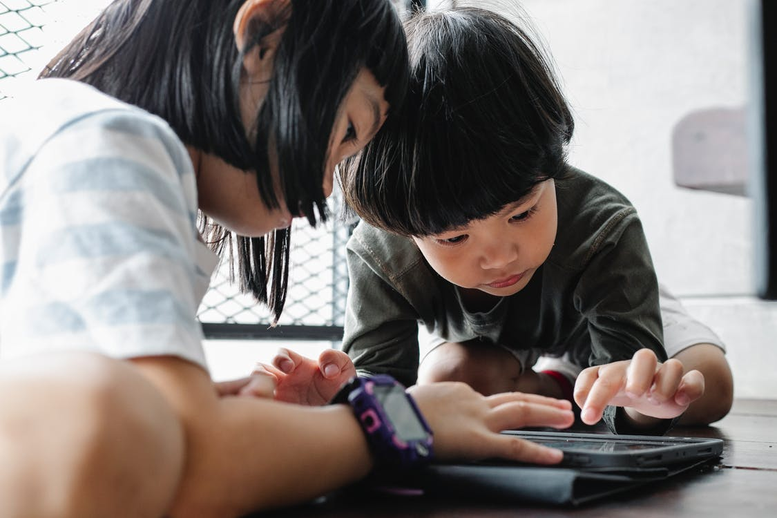 Kids Playing on Their Tablet