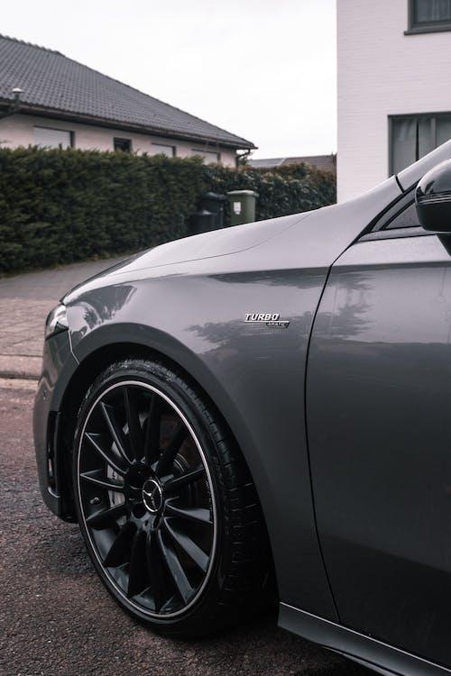 Black Car Parked on Gray Concrete Pavement