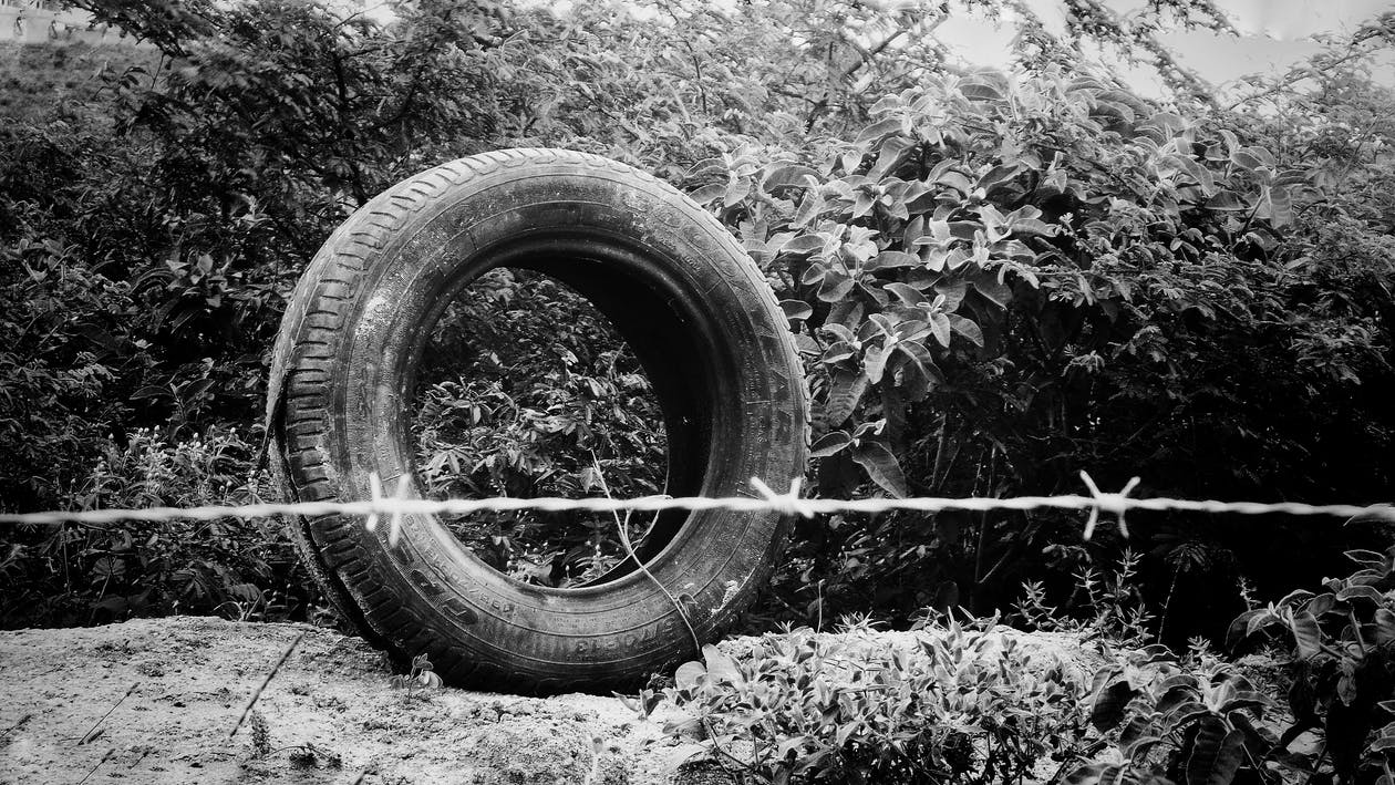 Free stock photo of black and white, flat tire, old tire