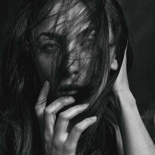 Grayscale Photo of Woman's Hair Covering Her Face