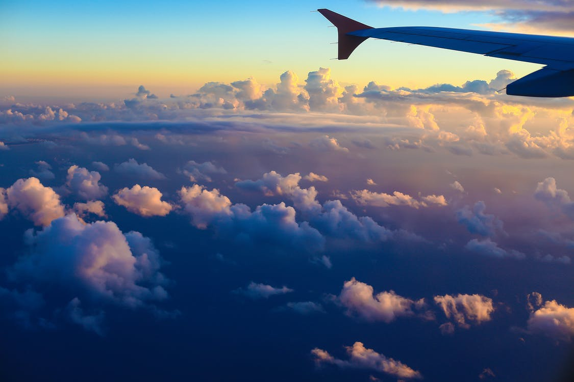 Airplane wing in scenic evening sky
