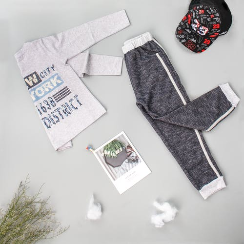 Stylish cotton wear for kid on gray background