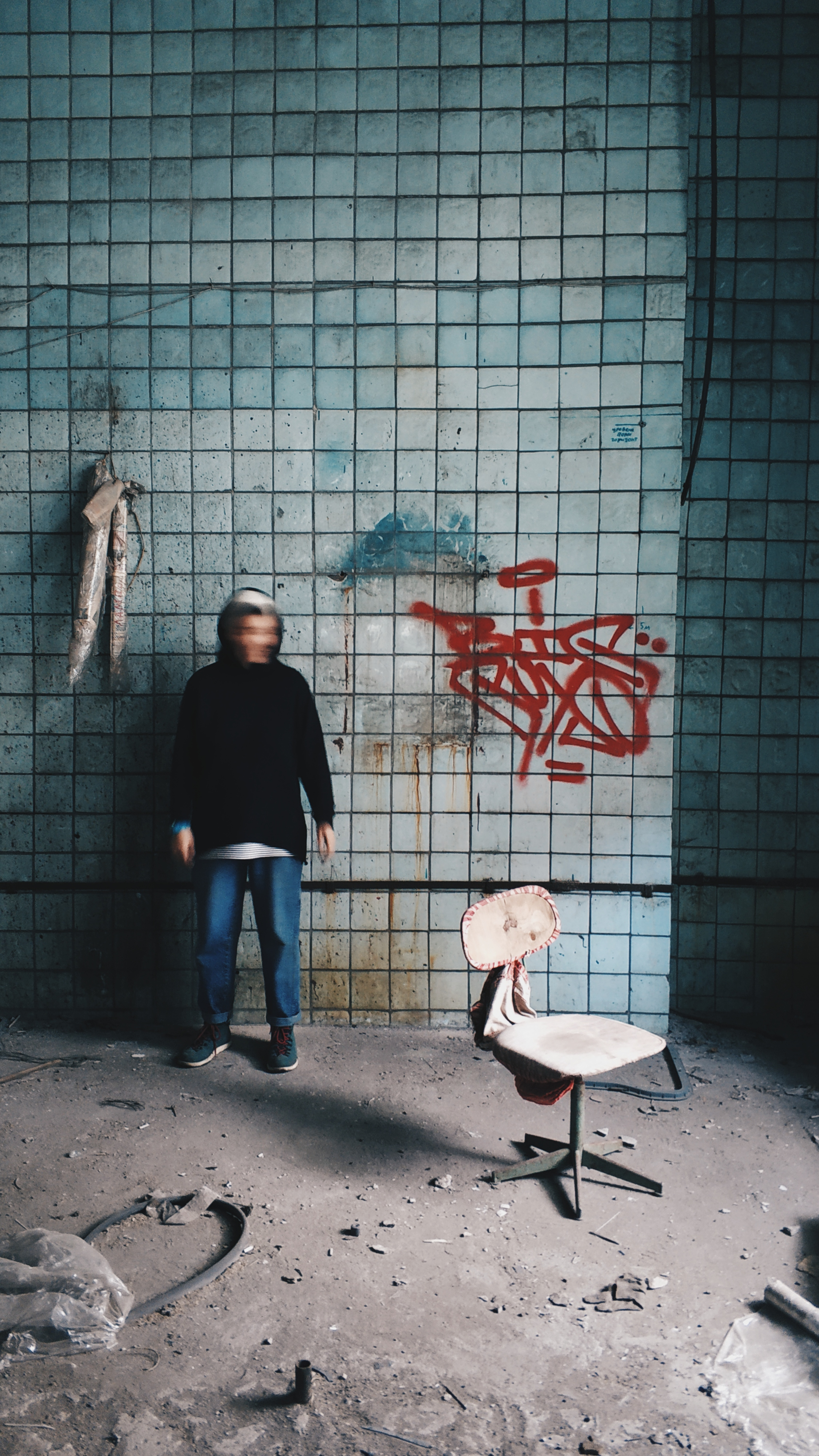 Unrecognizable Anxious Man Near Tiled Wall In Abandoned Building Free Stock Photo