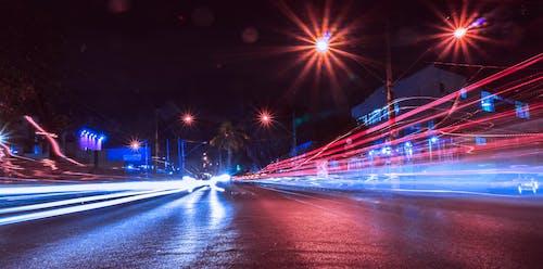 Asphalt road in night city