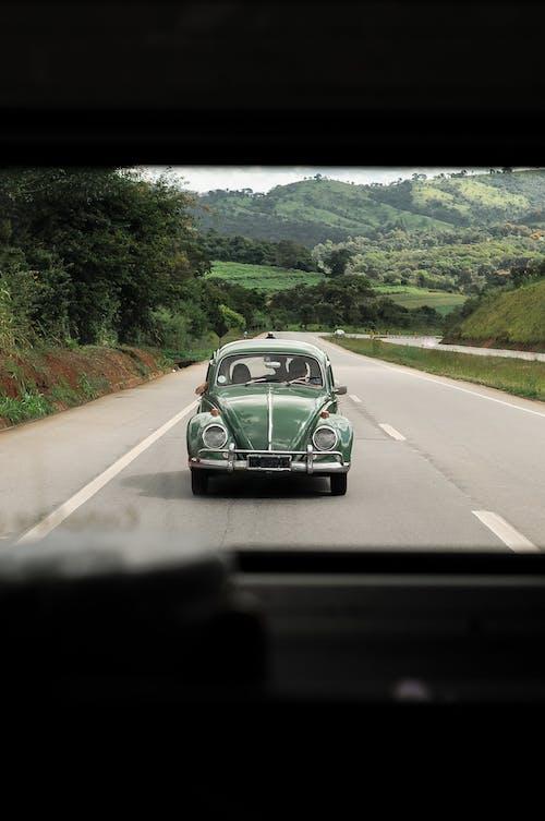 Retro car riding on asphalt road