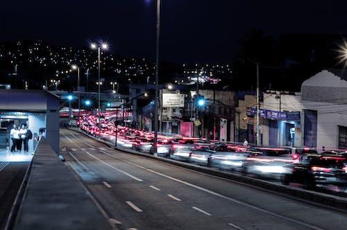Illuminated night city with busy traffic