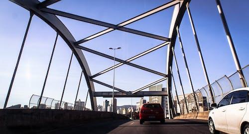 Modern cars on asphalt road on bridge
