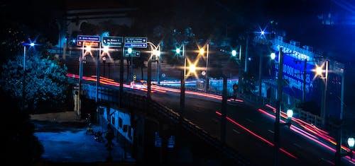 Illuminated street with traffic on road