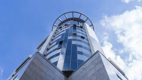Facade of geometric building against sky