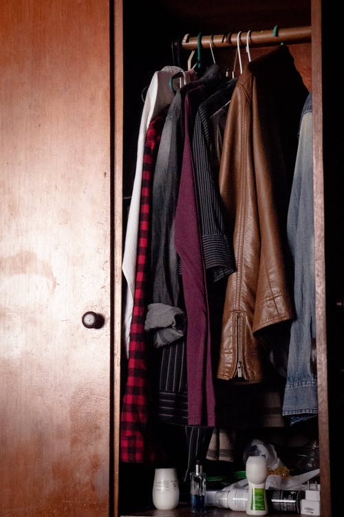 Wardrobe with casual clothes on hangers