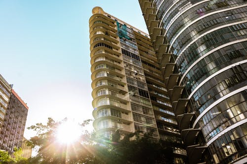 Contemporary residential buildings with sun light and green trees
