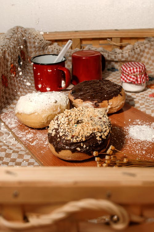 Delicious sweet donuts with chocolate and vanilla cream