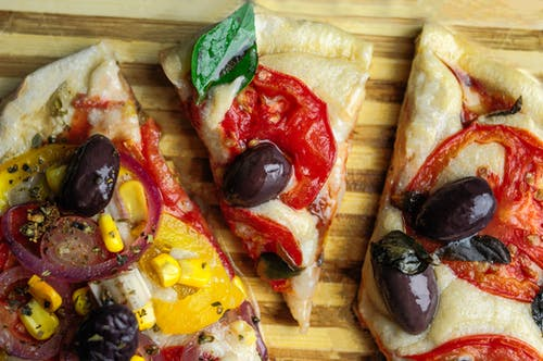 Pieces of pizza with tomato and cheese