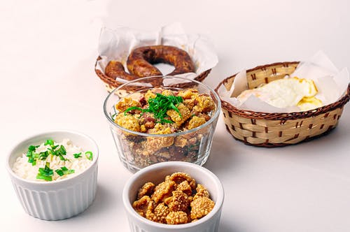 Tasty breakfast served in wicker and ceramic bowls