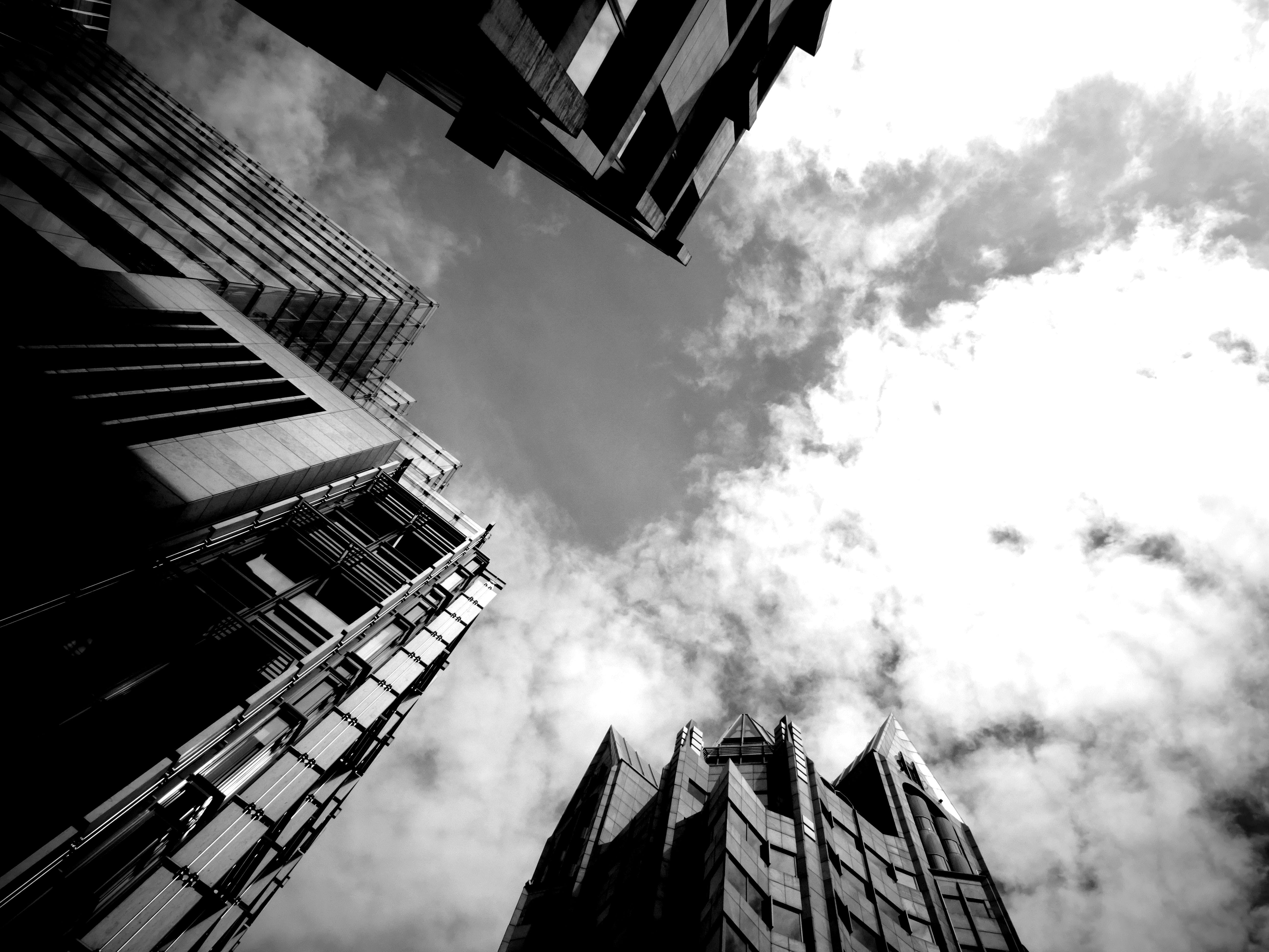 Grayscale and Low Angle Photography of High-rise Building