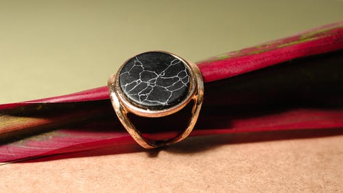 Expensive golden ring with mineral on leaf