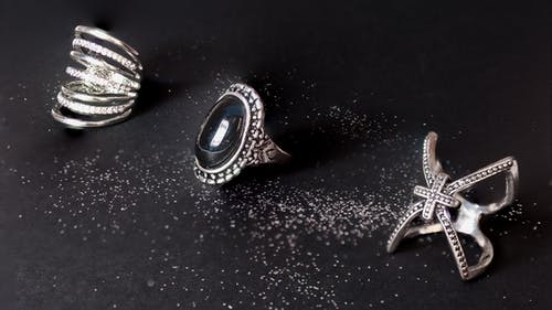 Set of silver rings with mineral and jewels