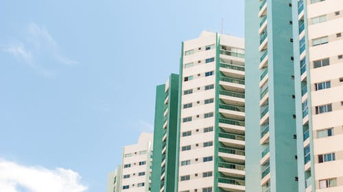 Blue cloudy sky over tall residential building