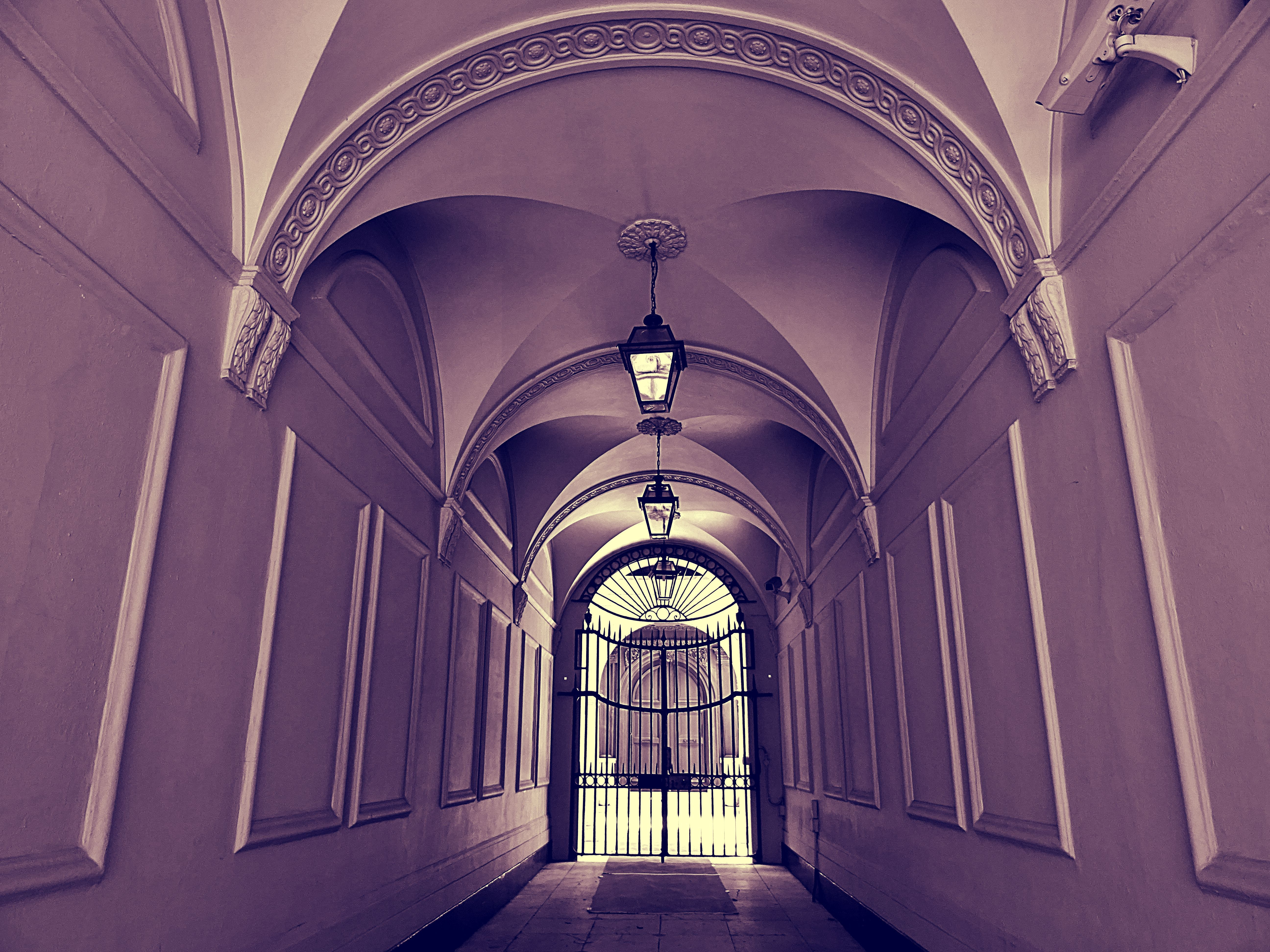 Empty Hallway and Closed Gate