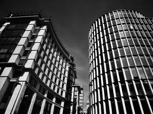 Grayscale Photograph of High-rise Concrete Buildings