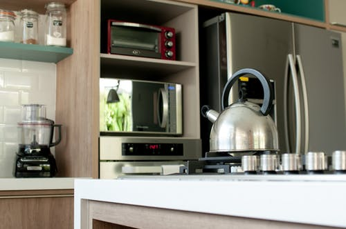 Metal kettle on stove in modern kitchen