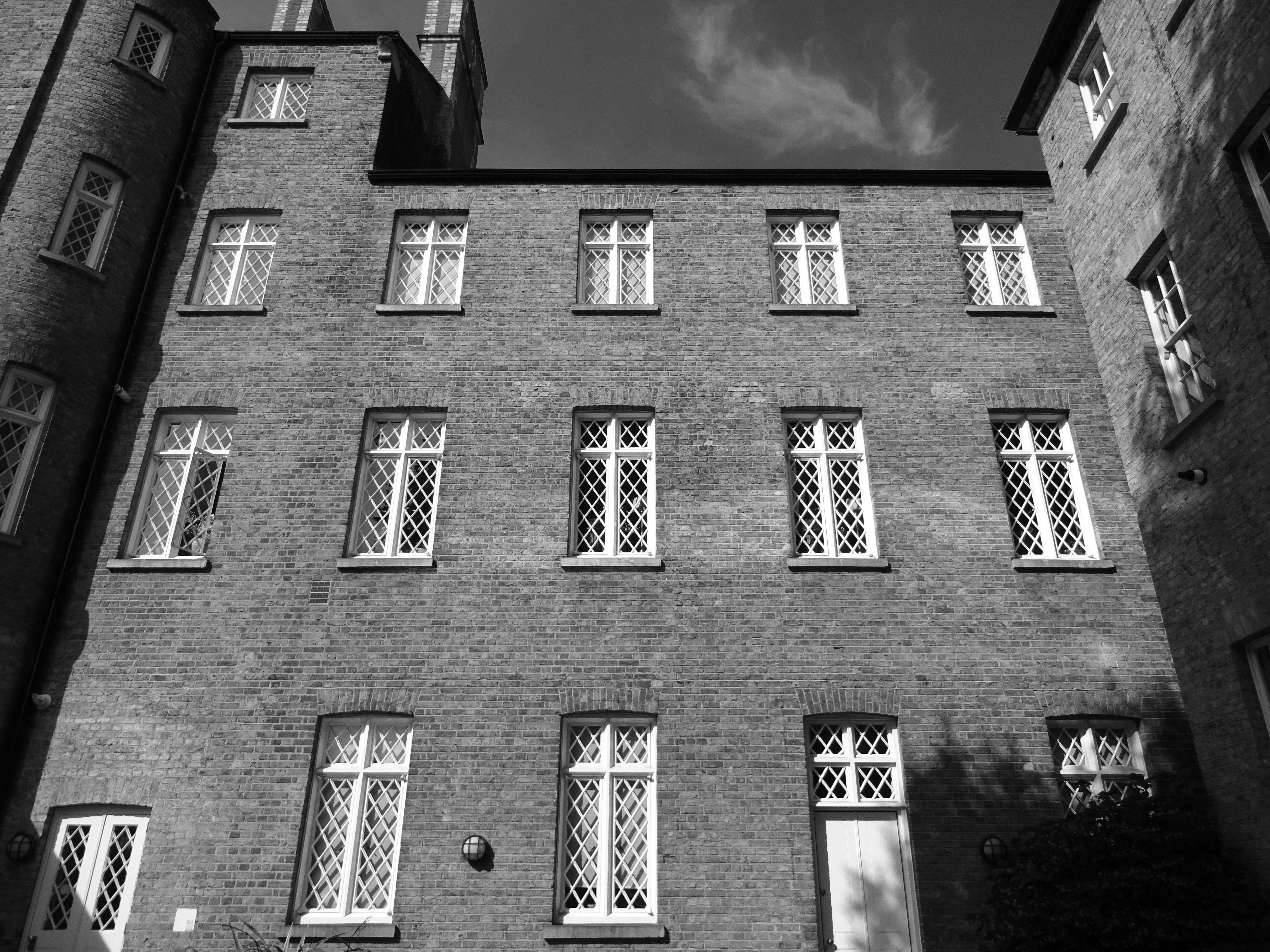 Grayscale Photography of 3-storey Building