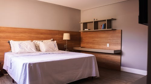White bed in minimalist room