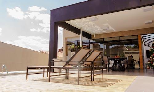 Sunbeds placed on terrace of villa