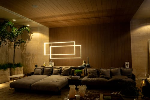 Cozy living room design with comfy sofa and creative lamp