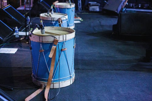 Acoustic drum set with microphones on stage