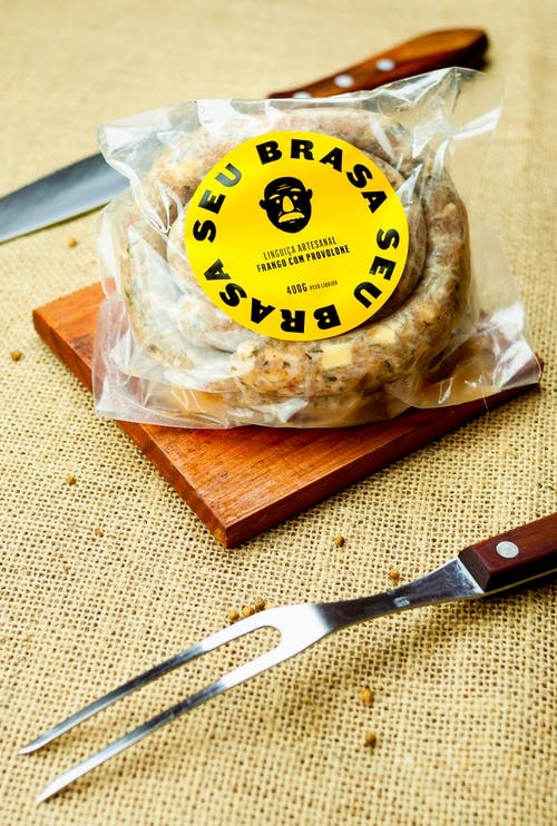 Pack with rolled wurst on wooden board
