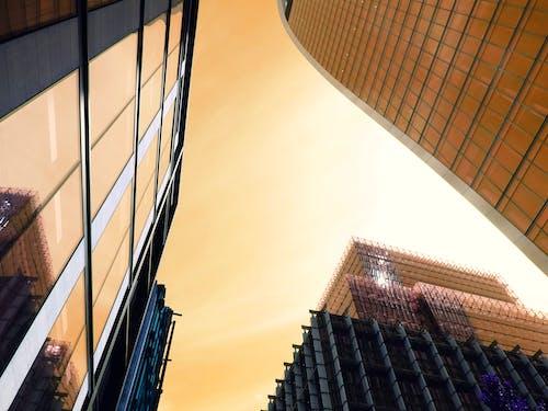 Gratis arkivbilde med arkitektur, bygninger, daggry, glasselementer