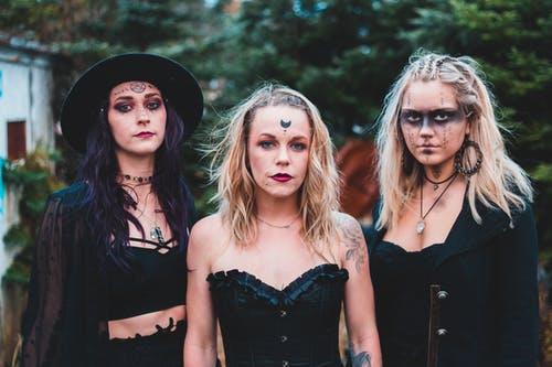 Women in stylish boho Halloween outfits