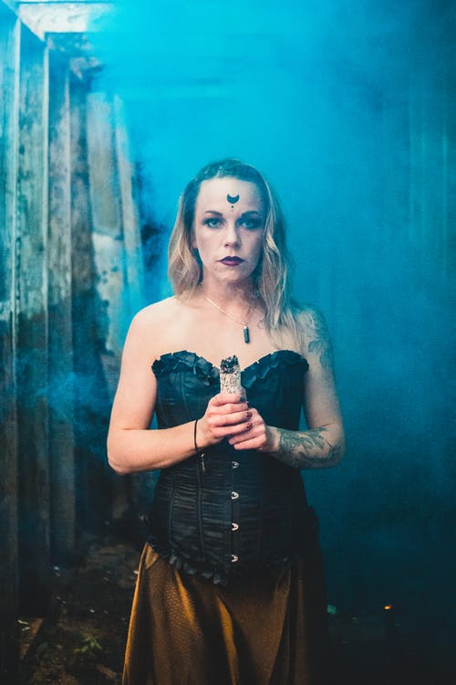 Sorceress with sage in blue smoke