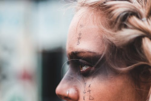 Mysterious woman with dark makeup and symbols