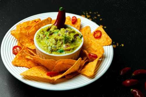 Traditional Mexican food with nachos and guacamole