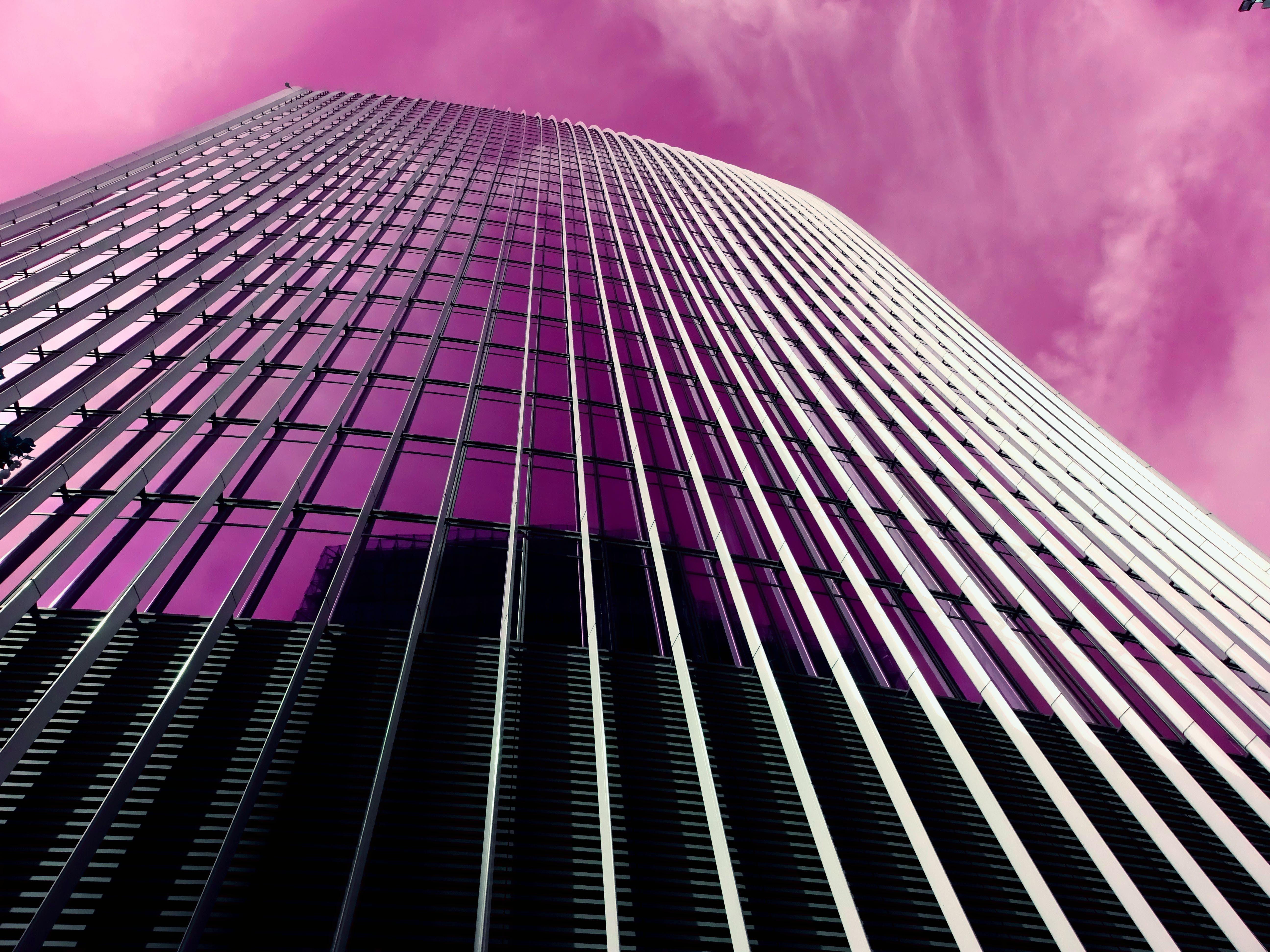 Gray Concrete High-rise Building Under Purple Sky