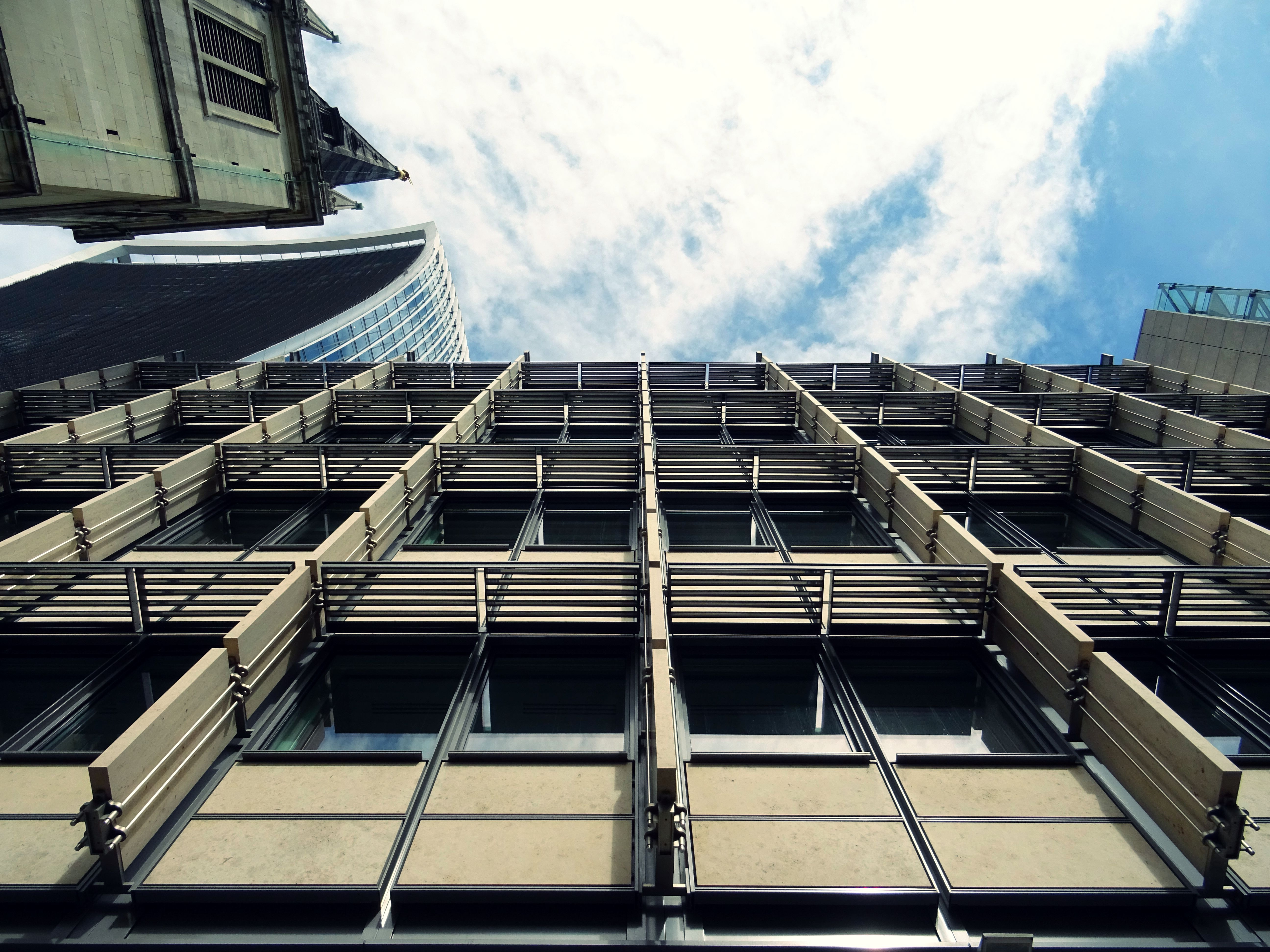 Low Angle Photography Of Glass Building · Free Stock Photo