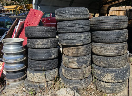 Free stock photo of auto tires, city dump, environment, junk yard