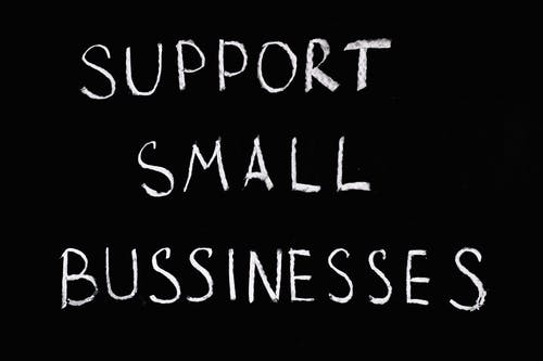 Support Small Businesses Lettering Text on Black Background
